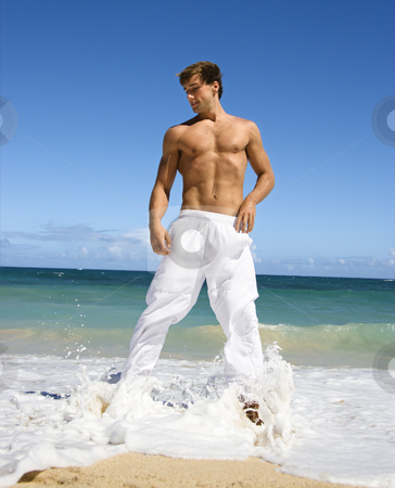 Attractive fit man. stock photo, Physically fit shirtless man standing on Maui, Hawaii beach. by Iofoto Images