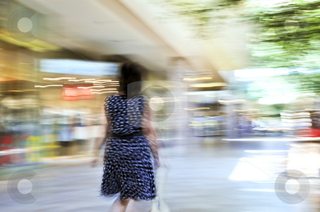 Shopping in a mall stock photo, Woman shopping in a mall, panning shot, intentional in-camera motion blur by Elena Elisseeva