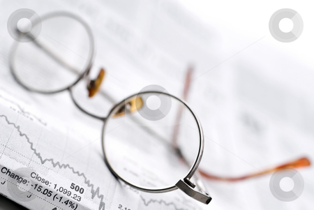 Glasses on a newspaper stock report stock photo, Glasses on a newspaper stock report by Vince Clements
