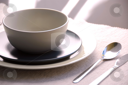 Dinner place setting stock photo, Dinner place setting with plates and soup bowl by Elena Elisseeva