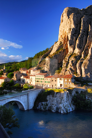 Town of Sisteron in Provence France stock photo, Houses at the base of a cliff in town of Sisteron in Provence by Elena Elisseeva