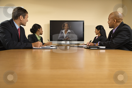Business presentation. stock photo, Businesspeople sitting at conference table looking at flat screen display. by Iofoto Images