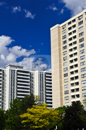 Apartment buildings stock photo, Tall residential apartment buildings with blue sky by Elena Elisseeva