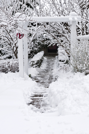 Winter garden stock photo, Path leading to a house after heavy snowfall by Elena Elisseeva