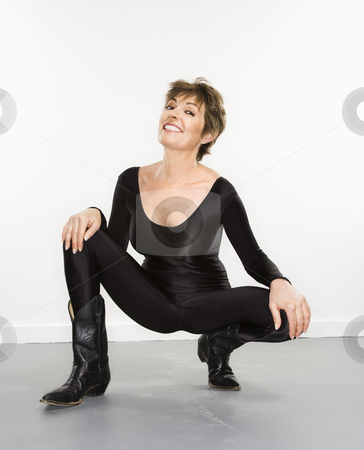Sexy woman portait. stock photo, Portrait of pretty Caucasian woman in spandex bodysuit and black cowboy boots smiling. by Iofoto Images