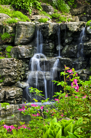 Cascading waterfall stock photo, Cascading waterfall in japanese garden in springtime by Elena Elisseeva