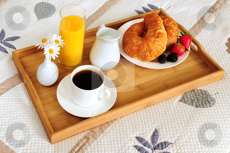 Breakfast on a bed in a hotel room stock photo, Tray with breakfast on a bed in a hotel room by Elena Elisseeva