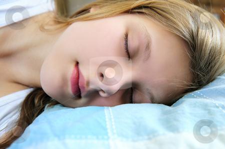 Teenage girl sleeping stock photo, Beautiful teenage girl sleeping in the morning by Elena Elisseeva