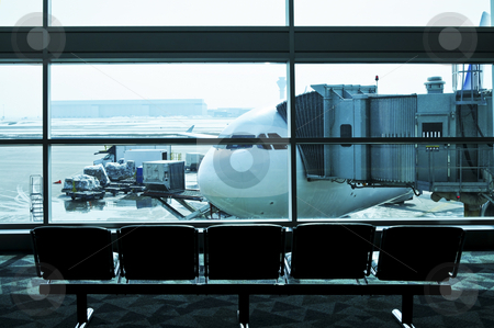 Airport interior stock photo, Waiting area of airport gate with airplane outside by Elena Elisseeva