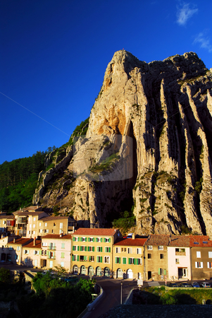 Town of Sisteron in Provence France stock photo, Houses at the base of a cliff in town of Sisteron in Provence, France by Elena Elisseeva