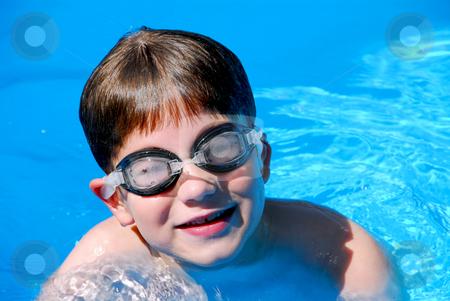 Boy child pool stock photo, Cute little boy having fun in a swimming pool by Elena Elisseeva
