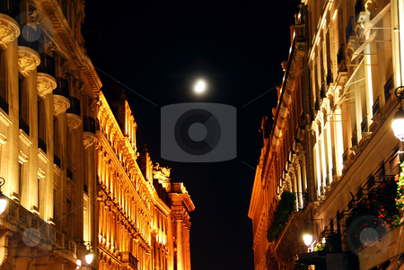 City of Light stock photo, Illuminated street in Paris France at night with bright moon by Elena Elisseeva