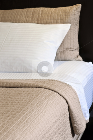 Comfortable bed stock photo, Comfortable bed in upscale hotel close up by Elena Elisseeva