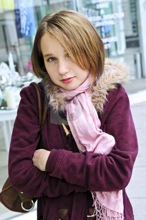Teenage girl shivering stock photo, Teenage girl shivering in cold weather outside by Elena Elisseeva