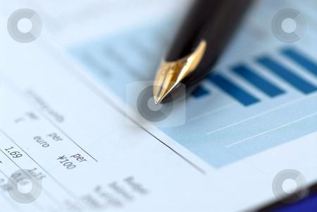 Pen finance chart stock photo, Golden fountain pen on financial chart by Elena Elisseeva
