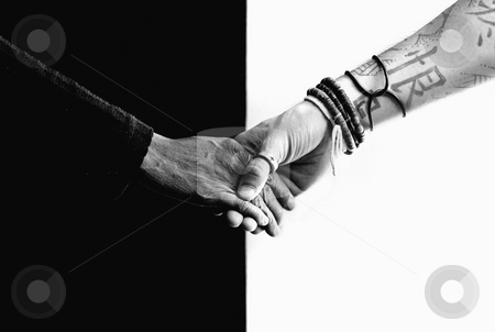 Black hand white hand stock photo, Close up of black and white hands holding each other by Scott Griessel