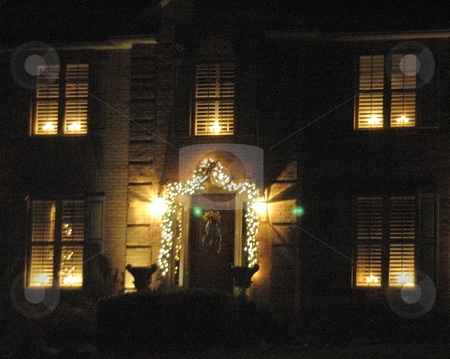 House decorated for Christmas stock photo, House is decorated on the outside for Christmas. by Janie Mertz