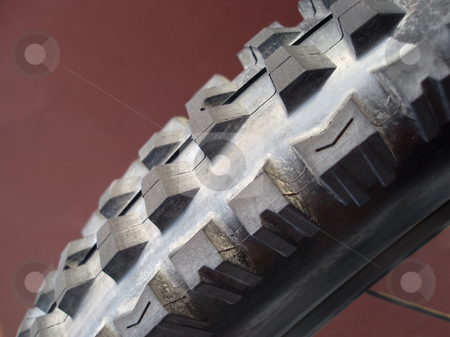 Bike tyre stock photo, Close up on a downhill mountainbike tyre by Stephen Gibson