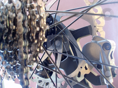 Mountainbike rear cassette stock photo, Detail of a mountain bike bear mechanism, rear cassette and disk brakes by Stephen Gibson