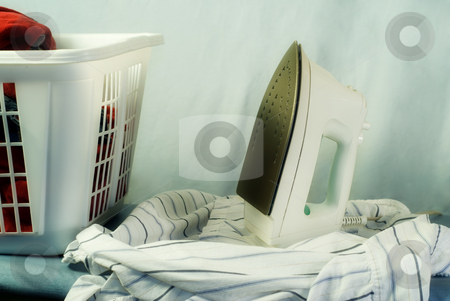 Laundry stock photo, Clean laundry about to be ironed on an ironing board by Richard Nelson