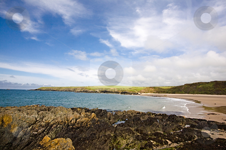 Rocky cove stock photo, A rocky beach in a pretty bay by Norma Cornes