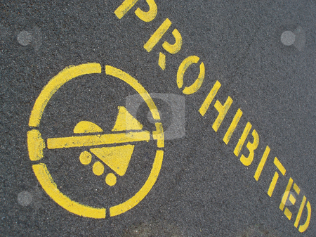 No skating stock photo, Yellow painted pavement sign prohibiting inline skating by Stephen Gibson