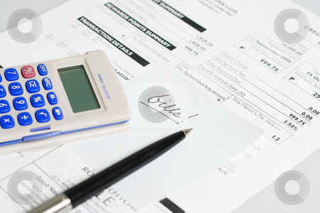 Bills stock photo, Monthly billing statement with pen and calculator by Jonas Marcos San Luis