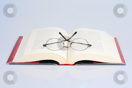 Open book stock photo, Open book with a pair of eye glasses on top by Jonas Marcos San Luis