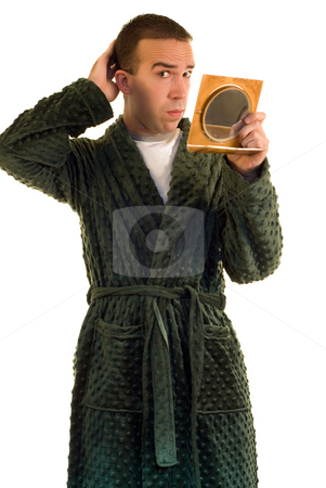 Metrosexual Male stock photo, A young male primping in front of a mirror by Richard Nelson