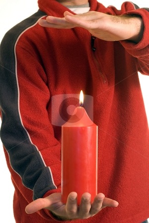 Heat stock photo, Someone warming their hand over a candle by Richard Nelson