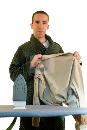 Guy Ironing stock photo, A young man ironing his shirt, isolated on a white background by Richard Nelson