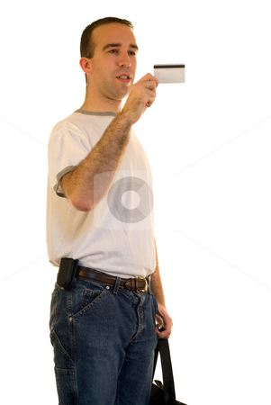 Male Shopping stock photo, A man looking at his credit card, isolated on white by Richard Nelson