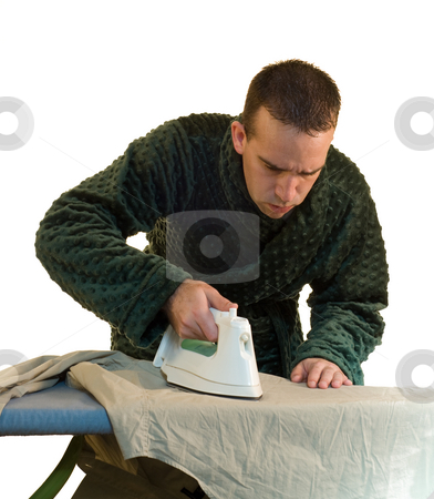 Male Housework stock photo, A young man concentrating on his ironing by Richard Nelson