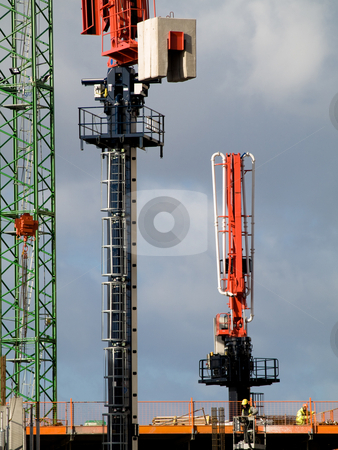 Industrial construction  site on a dock stock photo, Colored construction site with two workers in yellow by Laurent Dambies