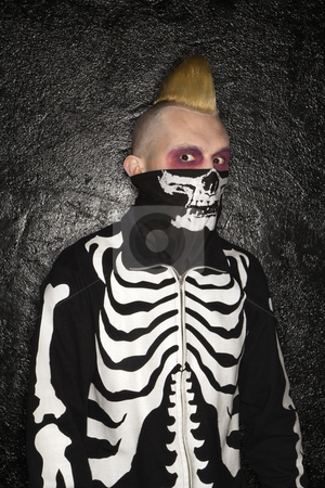 Punk with skeleton costume. stock photo, Mid-adult Caucasian male punk wearing skeleton sweatshirt and skeleton bandanna. by Iofoto Images