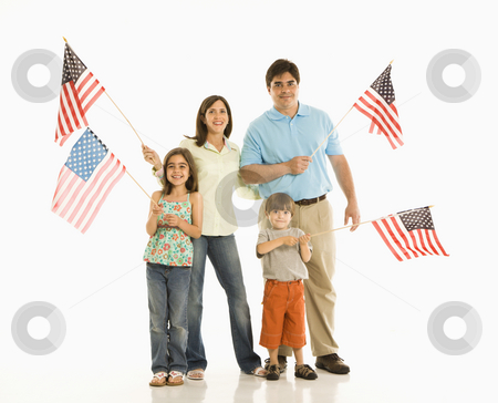 Family holding American flags. stock photo, Hispanic family holding American flags. by Iofoto Images