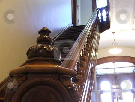 Oak bannister stock photo, The old oak bannister in the Madison County Courthouse in Winterset, Iowa is representative of local government buildings in Iowa.  The old courthouse and town of Winterset were featured in the movie and book,