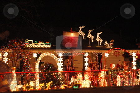 Christmas Decoration Overload stock photo, House is decorated to the max in the yard and on the house. by Janie Mertz
