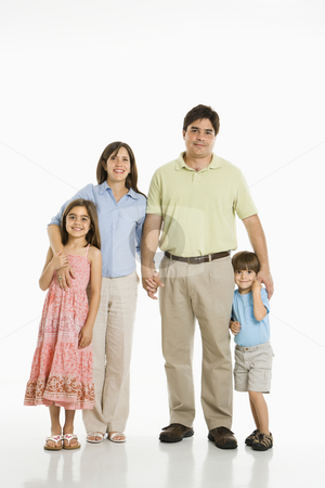 Hispanic family. stock photo, Hispanic family of four standing against white background. by Iofoto Images