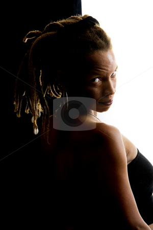 Pretty African American Woman stock photo, African American woman with dreadlocks against black and white wall by Scott Griessel