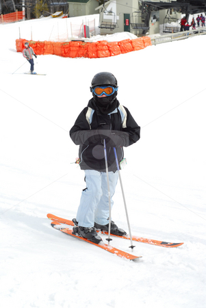 Child downhill ski stock photo, Young girl at downhill skiing resort by Elena Elisseeva