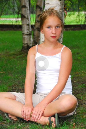 Young girl portrait stock photo, Portrait of a young pretty girl sitting under a birch tree in a park by Elena Elisseeva