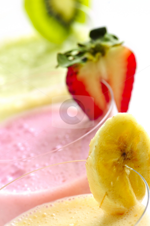 Assorted fruit smoothies stock photo, Assorted fruit and berry smoothies close up by Elena Elisseeva