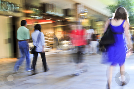 Shopping in a mall stock photo, People shopping in a mall, panning shot, intentional in-camera motion blur by Elena Elisseeva