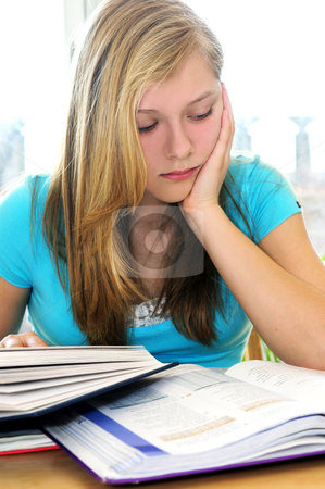 Teenage girl studying with textbooks  stock photo, Teenage girl studying with textbooks looking unhappy by Elena Elisseeva