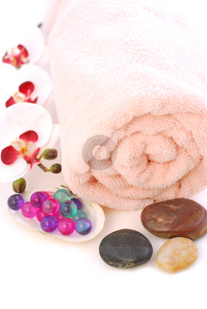Spa stock photo, Pink rolled up towel with massage stones and bath beads on white background by Elena Elisseeva