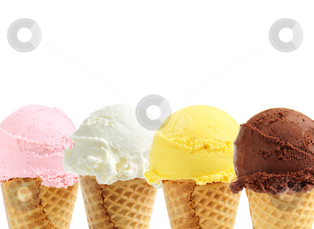 Assorted ice cream in sugar cones stock photo, Assorted ice cream in sugar cones on white background by Elena Elisseeva