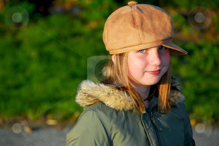Girl winter hat stock photo, Portriat of a young smiling girl in winter or fall clothes outside by Elena Elisseeva