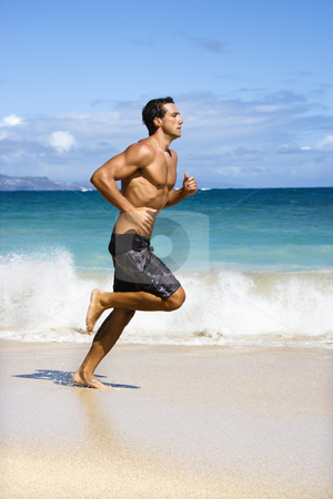 Man running. stock photo, Physically fit man running on Maui, Hawaii beach. by Iofoto Images