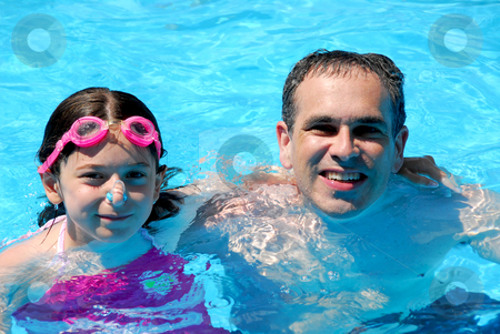 Father daughter pool stock photo, Father and daughter having fun in a swimming pool by Elena Elisseeva
